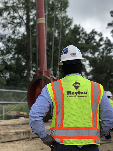Reytec employee in safety gear